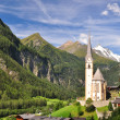 Stock Photo: Heiligenblut church in front of Grossglockner peak, Austria