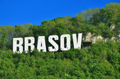 The name of the Brasov city in volumetric letters on Tampa mountain — Stock Photo