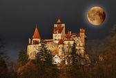 Dracula's Castle on full moon — Stock Photo