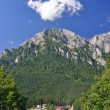 Stock Photo: Bucegi Mountains over a small town in Romania