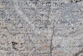Old greek inscription on marble in Delphi, Greece — Stock Photo