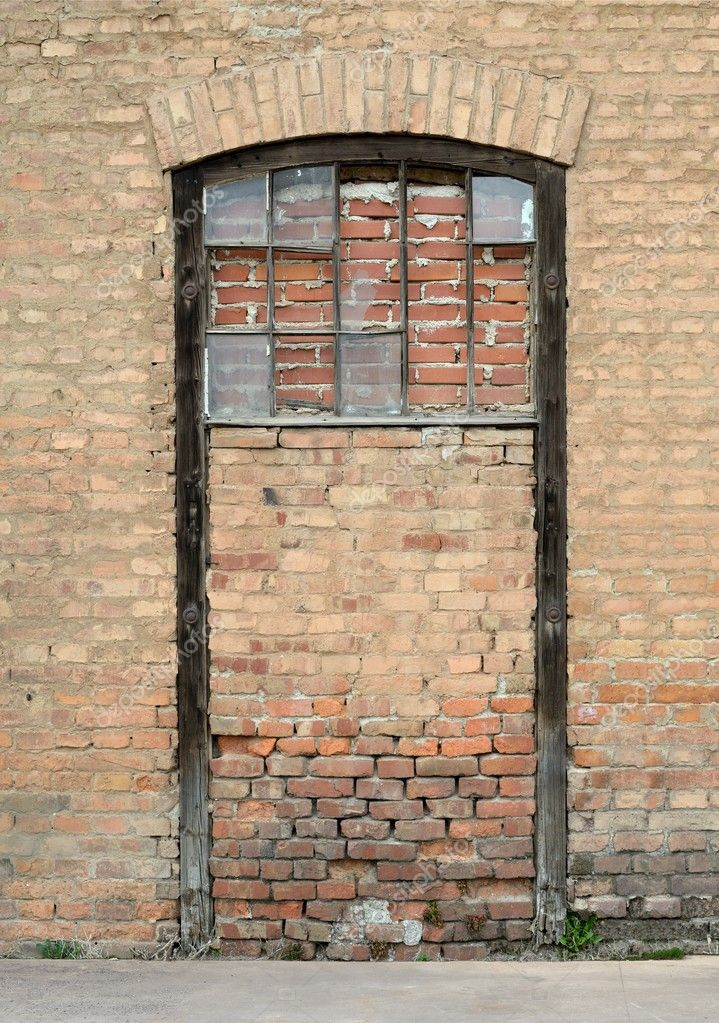 Old sealed door with brick wall — Stock Photo #10034783
