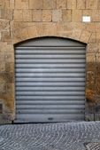Metal gray roll up door — Stock Photo