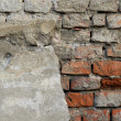Vintage damaged facade brick wall — Stock Photo