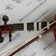 Old Violin closeup with notes and bow. — Stock Photo