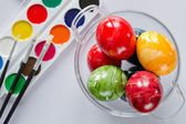 Ester eggs with brush and paint — Stock Photo