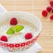 Porridge with raspberry — Stock Photo