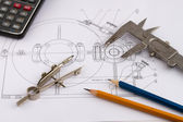Industrial drawing detail and several drawing tools — Stock Photo