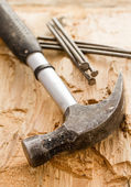 Hammer with nails — Stockfoto