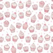 Seamless background with cupcakes — Stock Vector