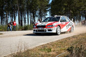 CASTELO BRANCO, PORTUGAL - MARCH 10: Diogo Salvi drives a Mitsubishi Lancer EVO VII during Rally Castelo Branco 2012, integrated on Open Championship in Castelo Branco, Portugal on March 10, 2012. — Stock Photo