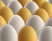 Set of golden and white eggs — Stock Photo