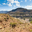 Rocky mountain landscape with dry riverbed — Stock Photo