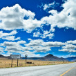 Stock Photo: Road through desolate landscape