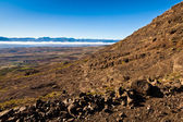 Desolate mountain landscape with rocks in the front — Stock Photo