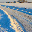 Snow covered road in winterlandscape — Stock Photo