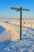 Road sign in winter landscape — Stock Photo