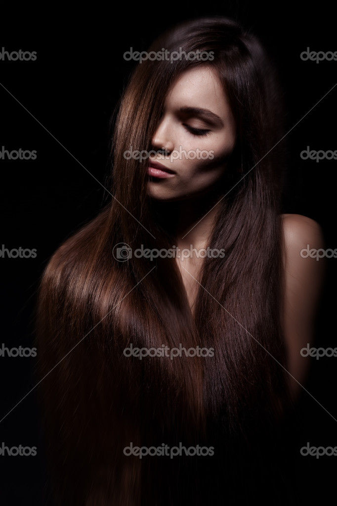 Studio portrait of attractive young woman with long hair — Stockfoto #8454616