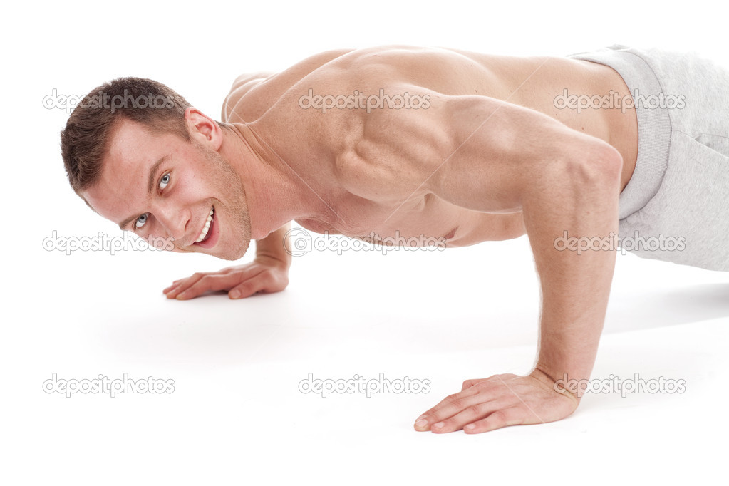 Handsome young muscular sports man on white background — Stock Photo #9376338