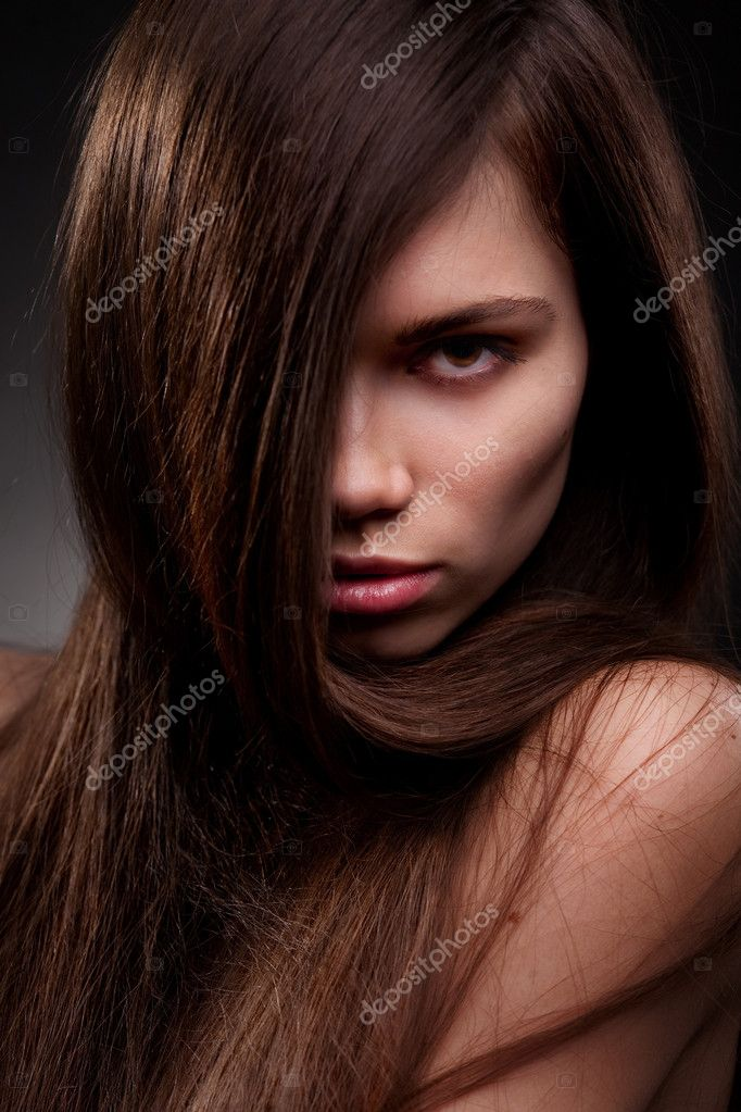 Studio portrait of attractive young woman with long hair  Stock Photo #9450896