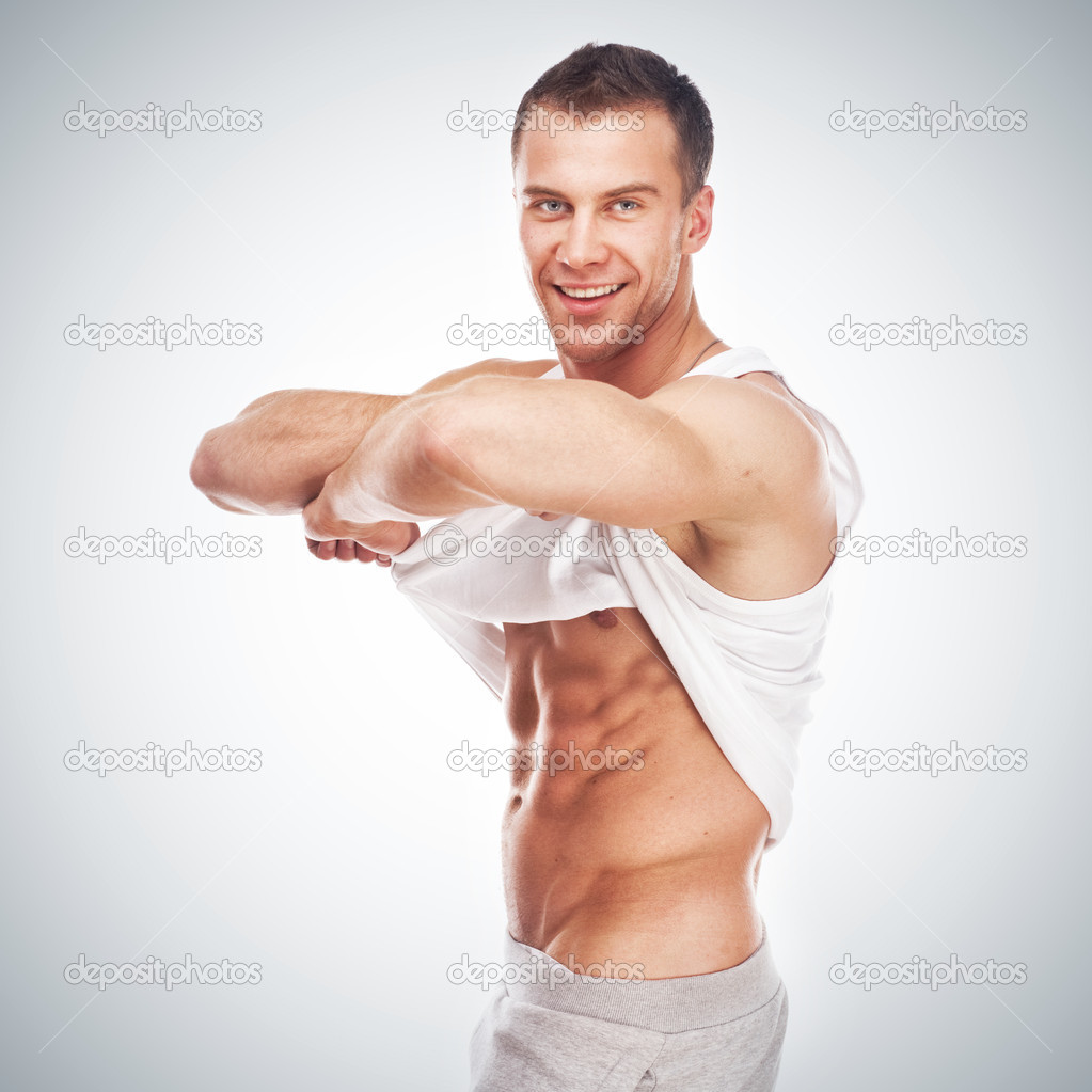 Handsome young muscular sports man on white background — Stock Photo #9450903