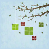 Cute gifts hanging on a tree — Stock Photo