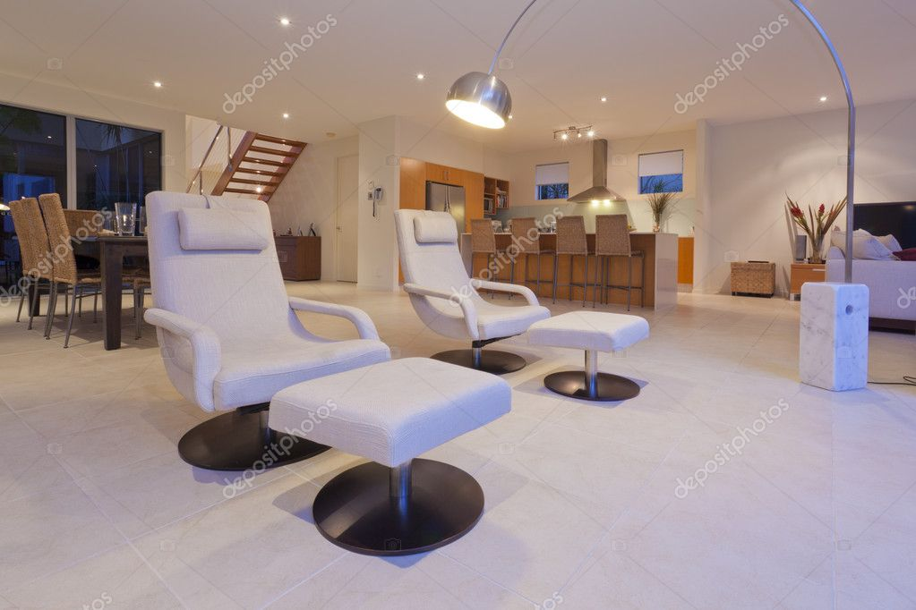 Stylish living room and kithchen with modern recliner chairs and lamp — Stock Photo #8593474