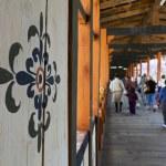 Постер, плакат: Bhutanese walk across the bridge of the Punakha Dzong Bhutan
