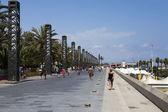 Promenade along the beach in Barceloneta - Barcelona, Spain — Stock Photo