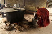 A monk takes soup in the kitchen of the monastery in Mandalay - Myanmar (Bu — Stock Photo