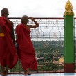 Royalty-Free Stock Photo: Two novices/ monks watch over Mandalay from Sagaing Hill - Myanmar (Burma)