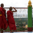 Two novices/ monks watch over Mandalay from Sagaing Hill - Myanmar (Burma) — Stock Photo