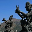 Buddhistic statues praising to the Tian Tan Buddha in Hong Kong - ストック写真