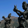 Buddhistic statues praising to the Tian Tan Buddha in Hong Kong - Stock Photo