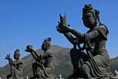 Buddhistic statues praising to the Tian Tan Buddha in Hong Kong — Stock Photo