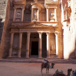 Stock Photo: Treasury with camels in Petr- famous temple of IndianJones in Jordan