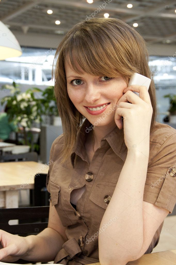 Close-up portrait of young beautiful woman talking on mobile phone  Stock Photo #10260008