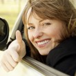 Portrait of happy smiling girl in the car — Stock Photo