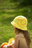Back view of toddler-girl in bonnet outdoors. — Stock Photo
