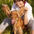 Smiling Girl has fun with her dog — Stock Photo