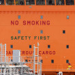 Stock Photo: No Smoking, Dangerous Cargo