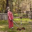 Scarecrow With Lawnmower — Stock Photo