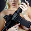 Topless babe with guns — Stock Photo