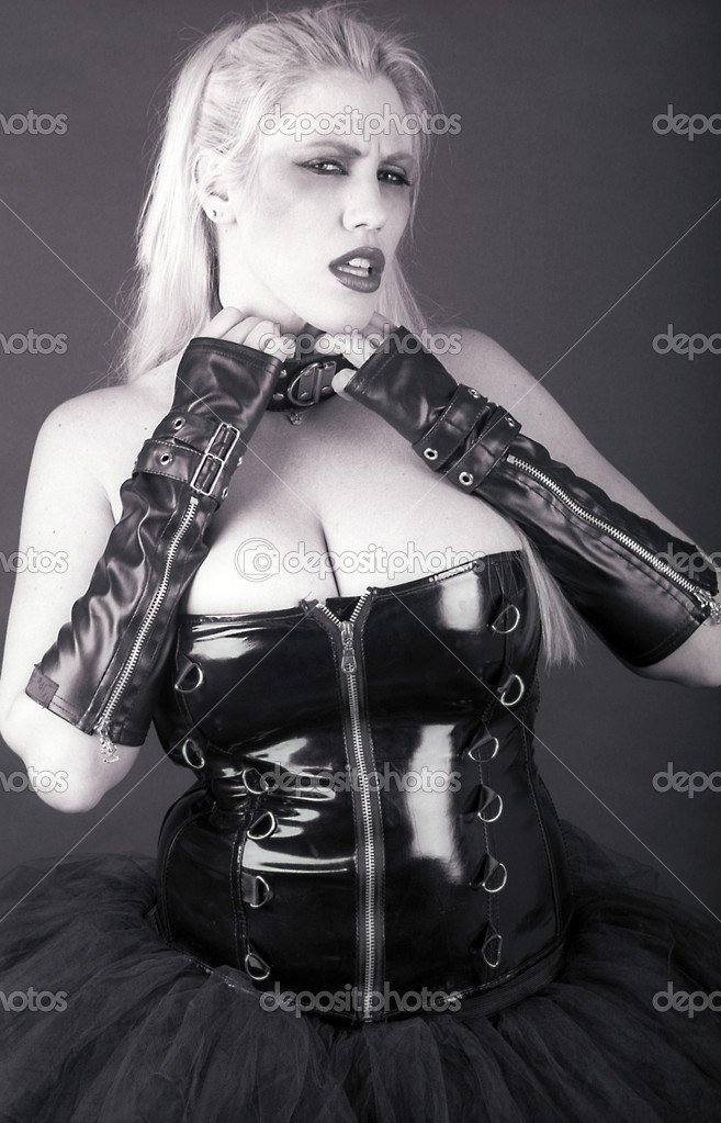 Busty gothic model wearing a black corset — Stock Photo #8809081