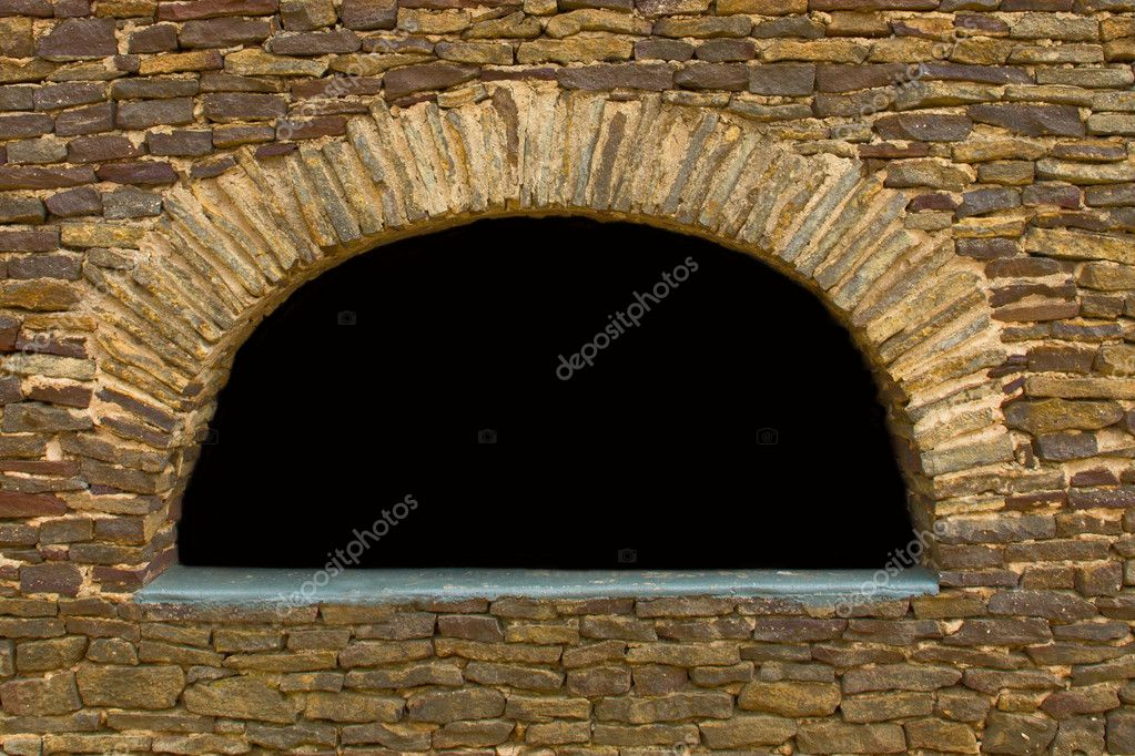 A standstone wall with an arched window — Stock Photo #8818322