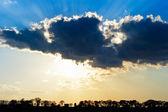 Sun Rays Beam through Dark Ominous Clouds — Stock Photo