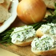 Baguette with spread from chives — Stock Photo #10404984