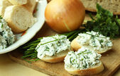 Baguette with spread from chives — Stock Photo