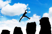 Man jumping off obstacles to the top — Stock Photo