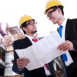 Architects Reviewing Blueprint — Stock Photo